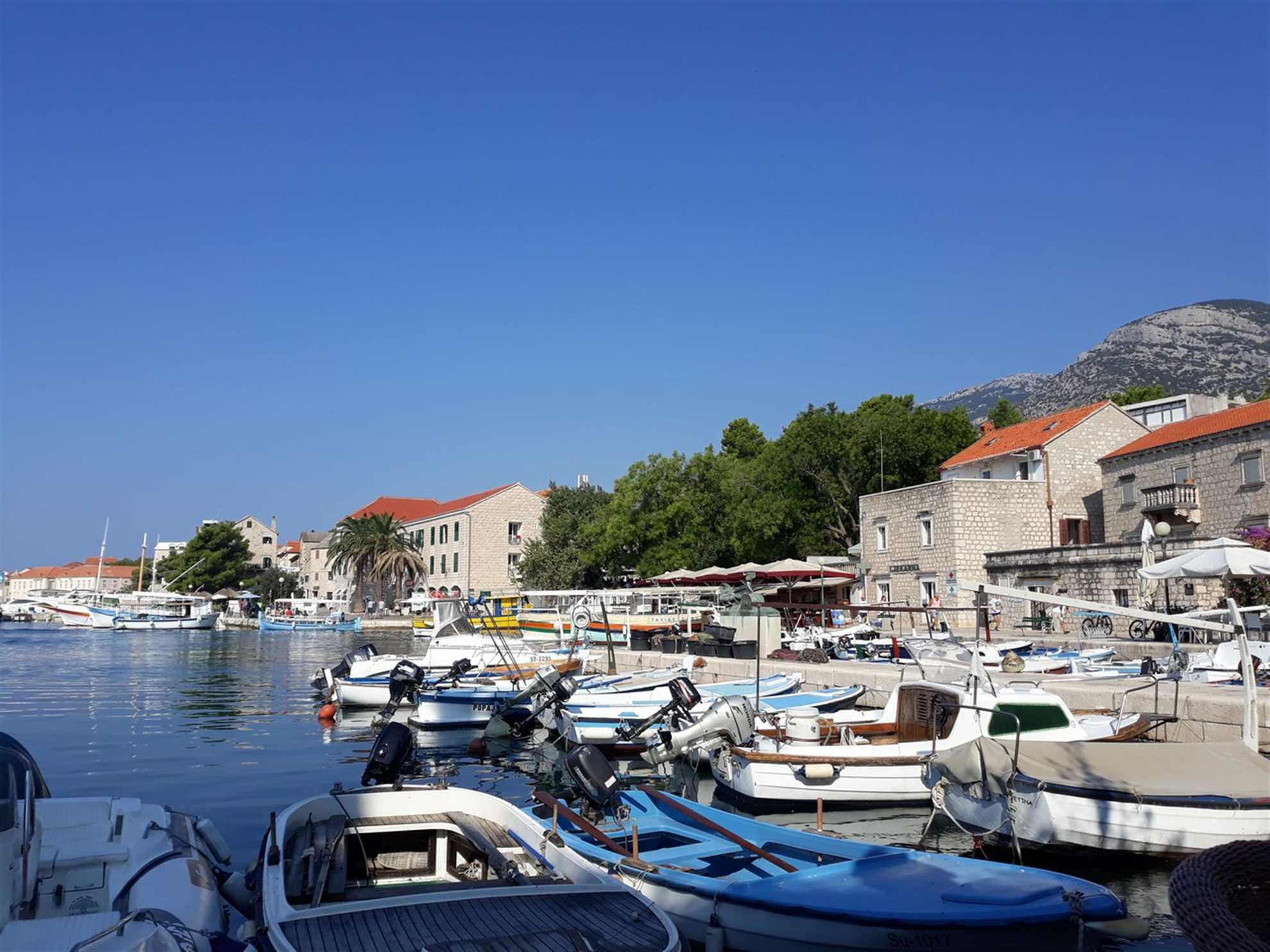 Port for small boats in the town of Bol on Brac island and Promenade