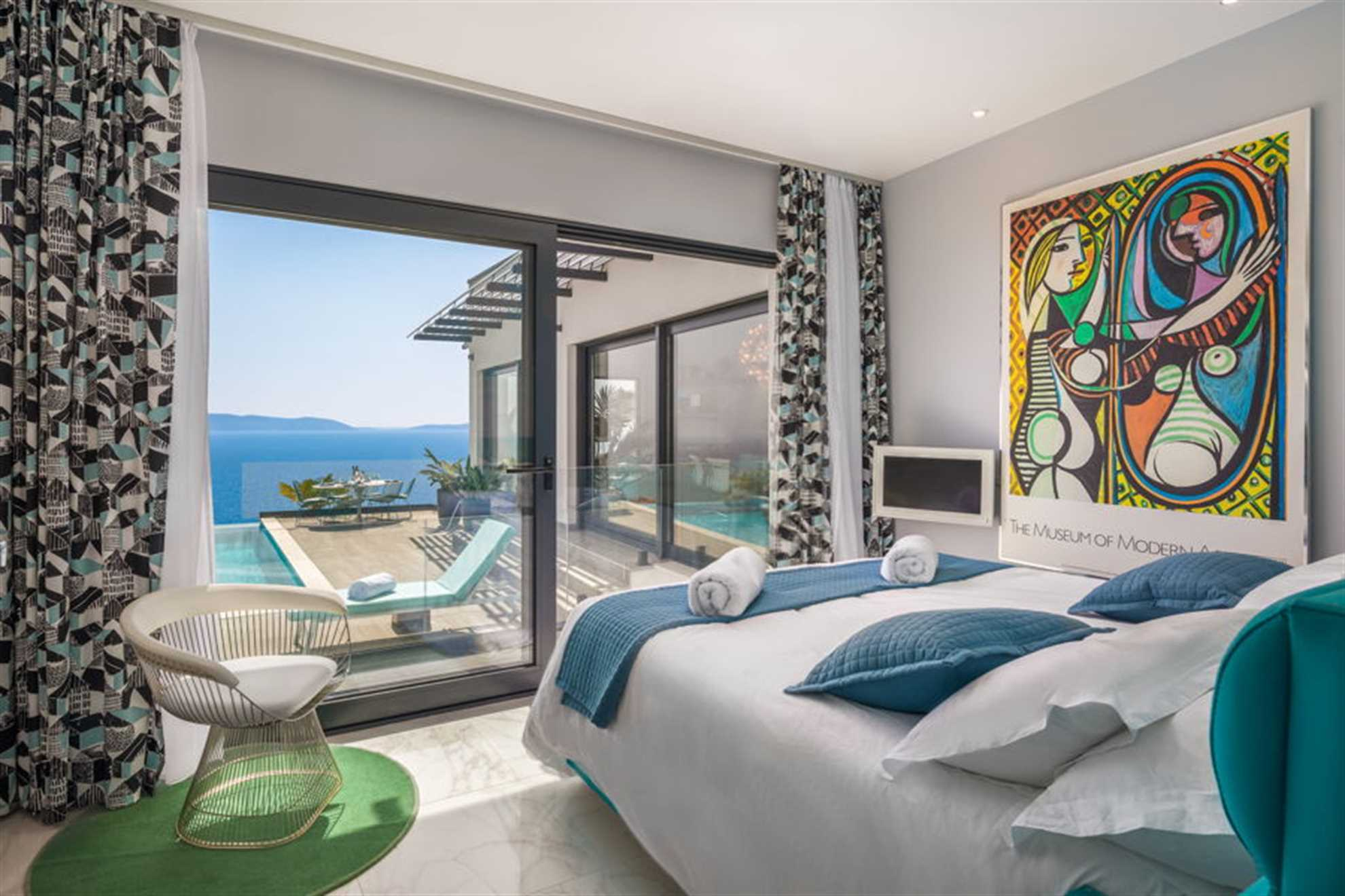 Bedroom near the pool terrace with sea view