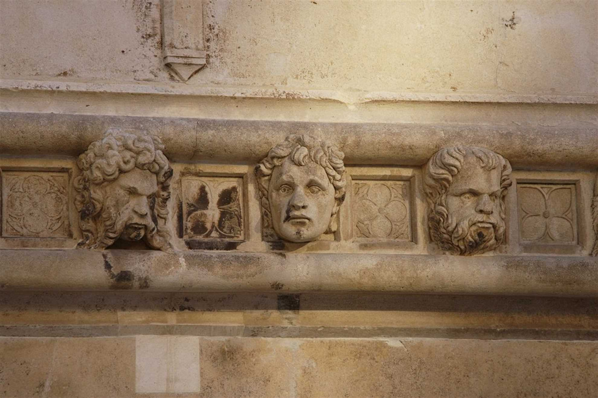 Heads on the St. James Cathedral facade